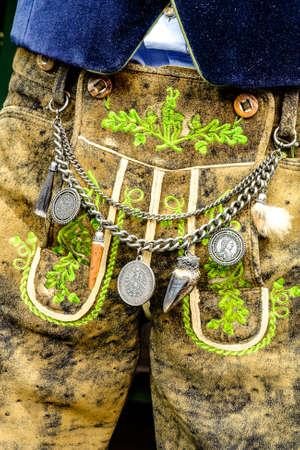 close-up of a typical bavarian krachlederne - traditional clothing with antique coins Stock Photo
