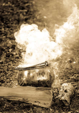 old photo: old cooking pot - outdoors - photo Stock Photo