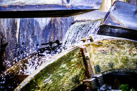 old waterwheel at a mill Stock Photo