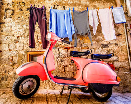 ROVINJ, CROATIA - MAY 9: typical Vespa small motorbike at the old street on may 9, 2017 in Rovinj, Croatia