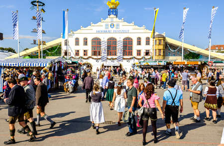 MUNICH, GERMANY - SEPTEMBER 26: people and fairground rides at the biggest folk festival in the world - the octoberfest on september 26, 2017 in munich. Editorial