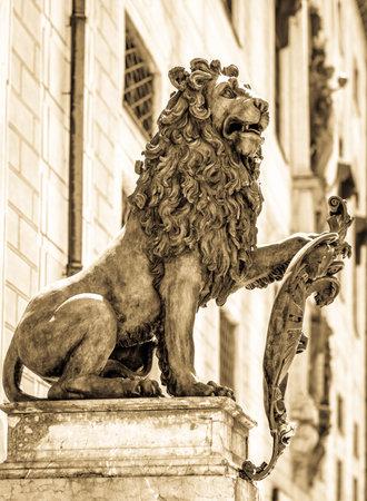 residenz: famous bavarian lion at the odeonsplatz in munich