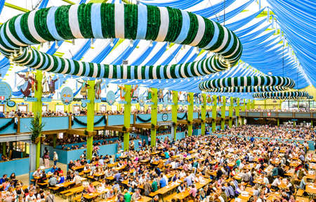 MUNICH, GERMANY - SEPTEMBER 28: people in the Spaten-beer tent at the biggest folk festival in the world - the octoberfest on september 28, 2017 in munich.