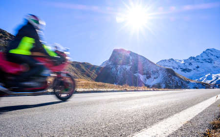 motorbike at the grossglockner mountain - blurred motion Stock Photo