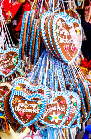 typical souvenir at the oktoberfest in munich - a gingerbread heart - lebkuchenherz Stock fotó - 90157087