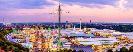 MUNICH, GERMANY - SEPTEMBER 25: people and fairground rides at the biggest folk festival in the world - the octoberfest on september 25, 2017 in munich.