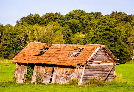 damaged roof: old blockhouse at the european alps Stock Photo