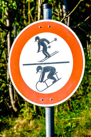 luger and skier warning sign Stock Photo