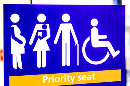 priority seat sign at a station