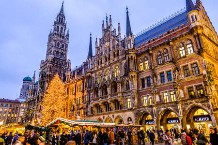 MUNICH, GERMANY - NOVEMBER 29: people and sales booth at the christmas market on November 29, 2017 in Munich, Germany