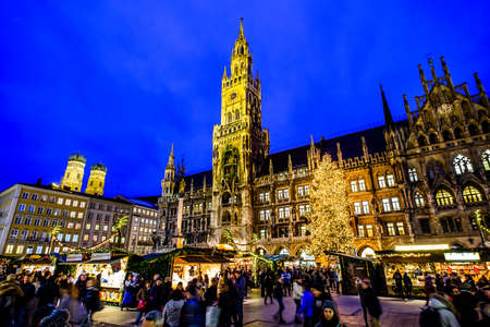 MUNICH, GERMANY - DECEMBER 18: people and sales booth at the christmas market on December 18, 2017 in Munich, Germany Editorial
