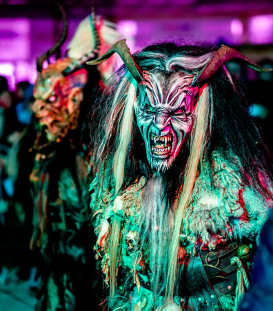 HEIMSTETTEN, GERMANY - DECEMBER 3: traditional krampuslauf with fantasy costumes and wooden masks on December 27, 2017 in Heimstetten, Germany Редакционное