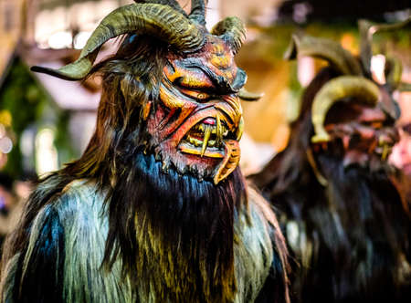 BAD TOELZ, GERMANY - DECEMBER 3: second traditional krampuslauf with fantasy costumes and wooden masks on December 9, 2017 in Bad Toelz, Germany Редакционное