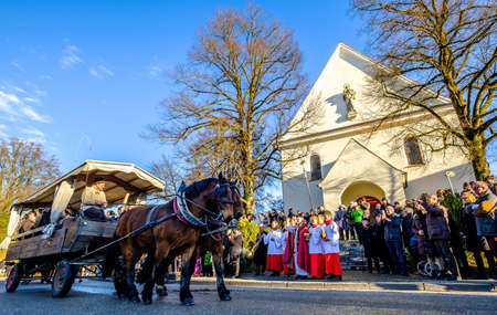 TUTZING, BAVARIAGERMANY - DECEMBER 26: people at the traditional horse-carriage procession with blessing, named stefaniritt on december 26 2017 in tutzing