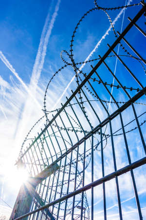 barbed wire in front of blue sky