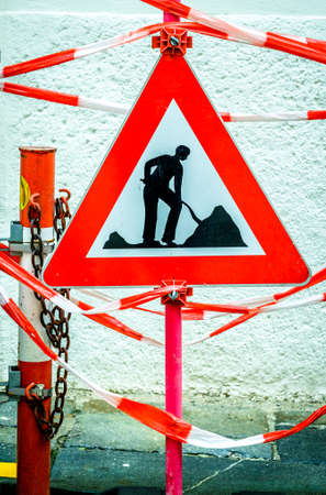 men at work sign at a road construction site Stock Photo