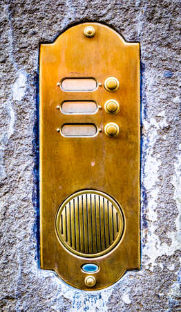 old bell buttons at a wall Stock Photo