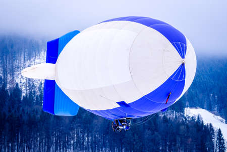 blimp (hot air airship) flying at the european alps 写真素材