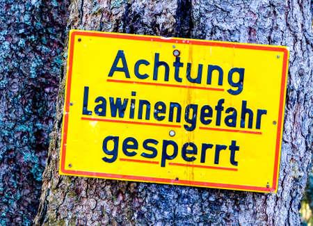 warning sign in germany - translation: look out, danger for landslide
