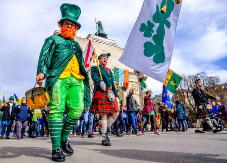 MUNICH - MARCH 11: People celebrating the annual national irish holiday St. Patricks day marching in the old town in munich, germany on March 11, 2018