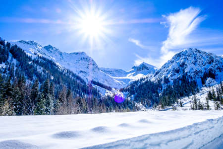 mountains at the village perstisau in austria in winter Banco de Imagens