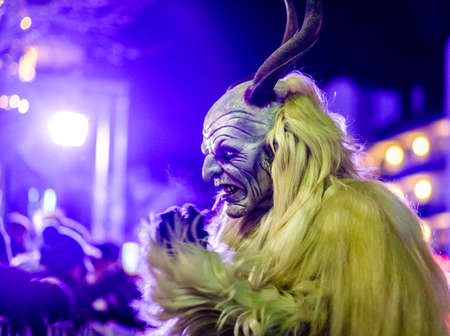 HEIMSTETTEN, GERMANY - DECEMBER 3: traditional krampuslauf with fantasy costumes and wooden masks on December 27, 2017 in Heimstetten, Germany Editorial