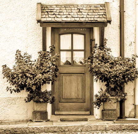 old entrance door and plants