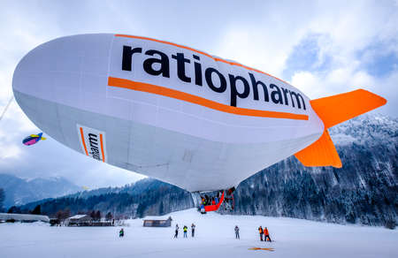 ROTTACH, GERMANY - FEBRUARY 21: blimp (hot air airship) flying at the european alps on feb 21, 2018 in rottach, germany Editorial