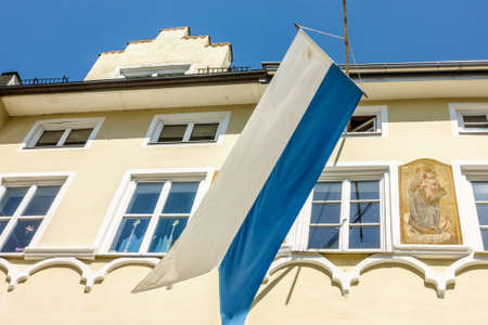 typical bavarian flag in the famous village bad toelz - old town Reklamní fotografie