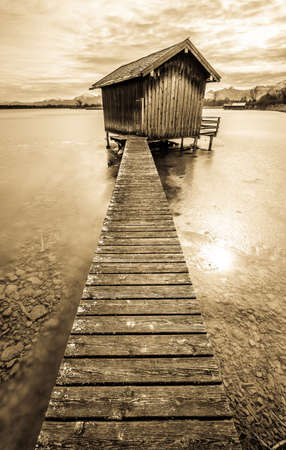 old wooden hut at a lake