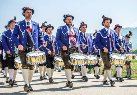 BICHL, GERMANY - MAY 6: a typical traditional bavarian parade for a saints day, called patronatstag, with 4000 gunmen in bichl, germany on may 6, 2018