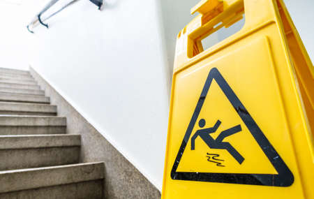 caution wet floor sign at a stairway