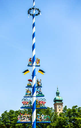 Munich, Germany - june 11: famous maypole at the Viktualienmarkt at a sunny day. It is a daily food market and a square in the center of Munich near Marienplatz on june 11, 2018 Editorial