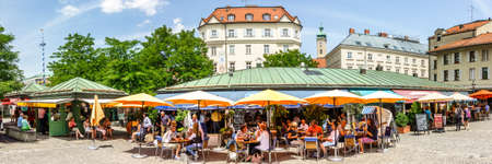 Munich, Germany - june 11: View of Viktualienmarkt a sunny day. It is a daily food market and a square in the center of Munich near Marienplatz on june 11, 2018