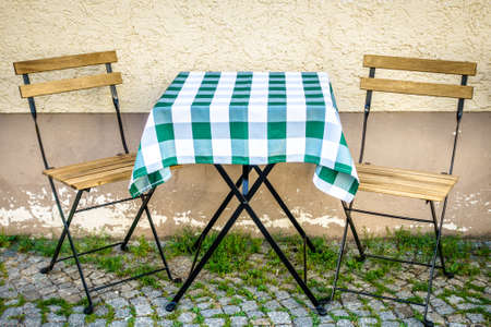 table and chair at a sidewalk cafe