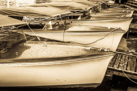 old electric boats at a lake Imagens