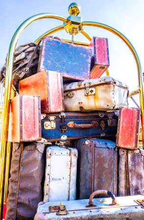 cart with old suitcases - photo