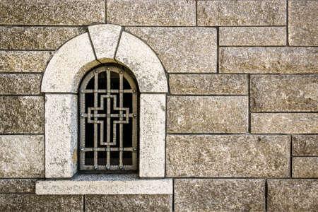 old church window with brick wall
