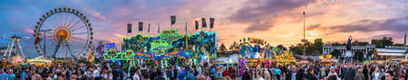 Munich, Germany - October 7: people and fairground rides at the biggest folk festival in the world - the oktoberfest on oktober 7, 2018 in munich. Editorial