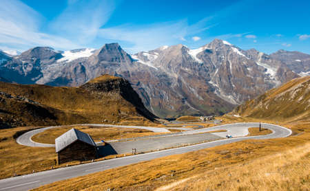winding country road at the european alps - grossglockner mountain austria