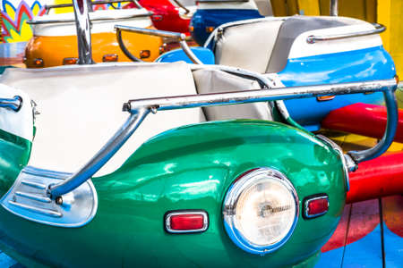 old carousel cars - close up Stock Photo