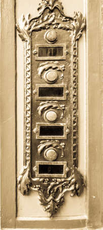 old bell buttons at a villa Stockfoto