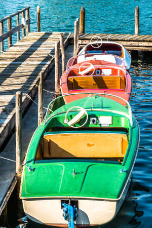 old pedal boats at a lake Stockfoto