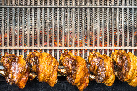 grilled knuckles at a market Stock Photo