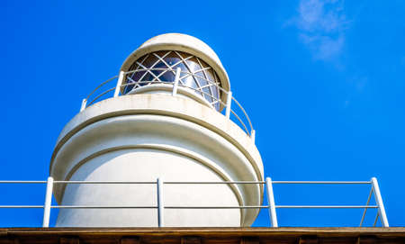 old lighthouse in front of blue sky
