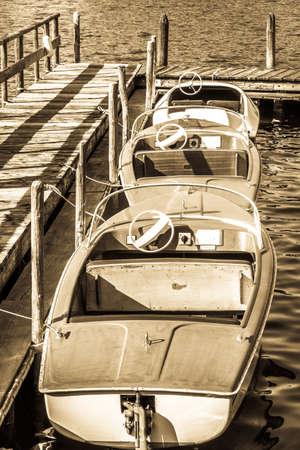 old pedal boats at a lake Stockfoto