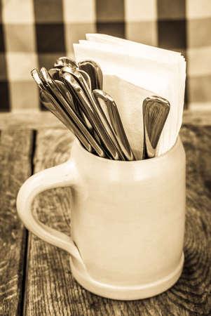 typical mug and silverware at a bavarian beergarden Imagens