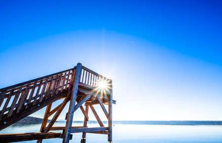 wooden diving platform at a lake 免版税图像