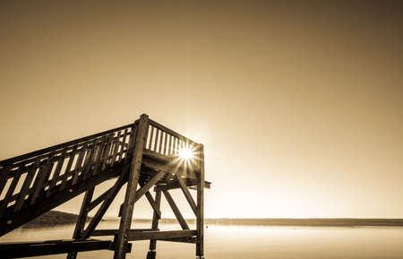 wooden diving platform at a lake