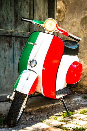 Parma, Italy - April 27: typical old Vespa small motorbike at the old town on April 27, 2018 in Parma, Italy